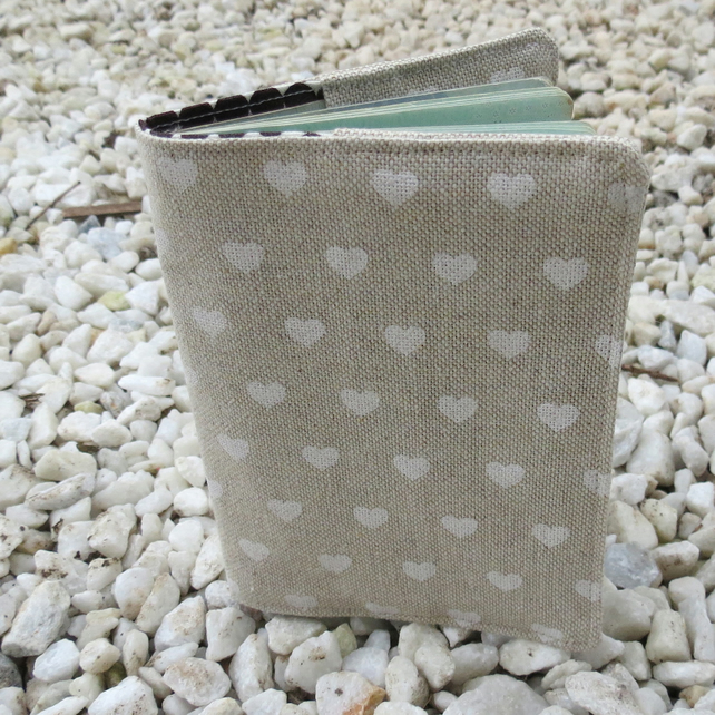 A passport sleeve with a scandi hearts design.  Passport cover.