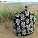 A large tea cosy with a skulls design. Made to fit a 4 - 5 cup teapot.