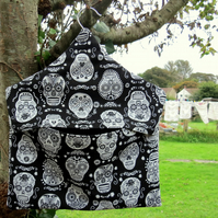 A peg bag with a skulls design.  Laundry.