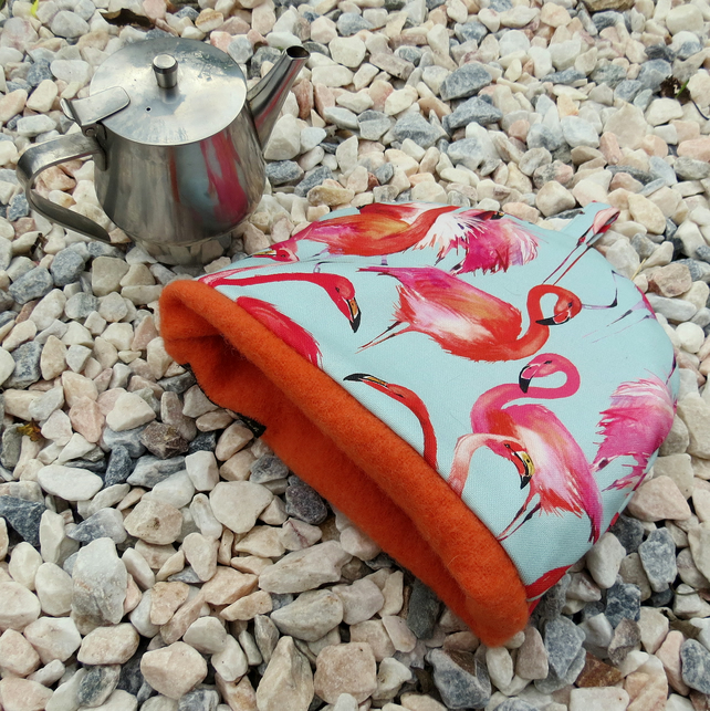 Flamingos.  A tea cosy, size small.  To fit a small 1- 2 cup teapot.