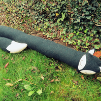 Long fox.  A draught excluder made from Donegal pure new wool.  Draft excluder.