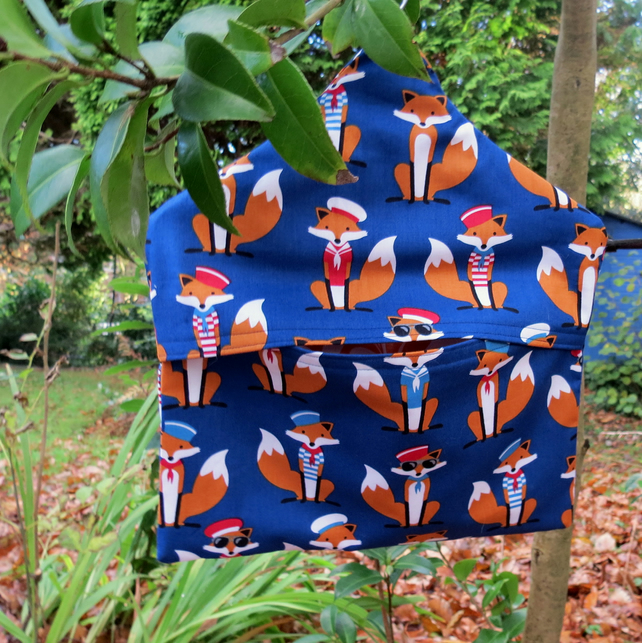 A peg bag with a whimsical fox design.   Laundry.  Peg storage.