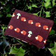 A Travel card holder. Oyster card wallet. Card holder.  Hedgehogs.