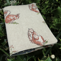 A passport sleeve with a squirrels design. Passport cover.