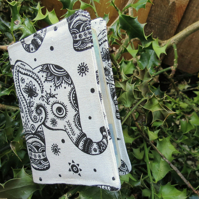 The regal elephant.  A whimsical passport sleeve.  Passport cover.