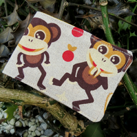 Oyster card holder. Travelcard Sleeve. A card holder with a monkeys design.