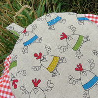 A coffee cosy.  Size large, to fit a 6 - 8 cup cafetiere.  Chickens.