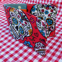 An Oyster card holder. Travelcard holder.  Skulls design.
