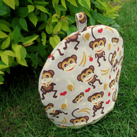 Large tea cosy.  A tea cosy with a monkeys design. To fit a 4-5 cup teapot.