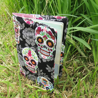 Skulls.  A passport sleeve featuring a skulls and flowers design.