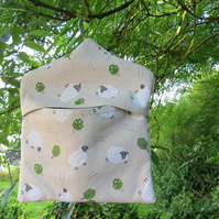 A peg bag with a sheep design.  Peg storage.