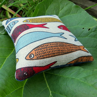 Pin Cushion.  A pin cushion with a fish design.