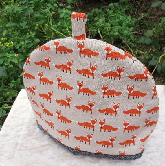 Tea cosy, size extra large.  To fit a 6 - 8 cup teapot.  Foxes.