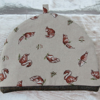 Large tea cosy.  Squirrels design.  Fabric tea cosy.
