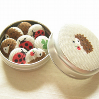 Hedgehog and optional ladybird fridge magnets in tiny tin. Beige