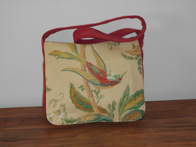 Red satchel messenger style bag with bird and floral front