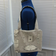 Small vintage label print tote bag in taupe and cream