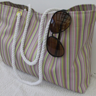 Tote beach bag in multi coloured stripes with rope handles