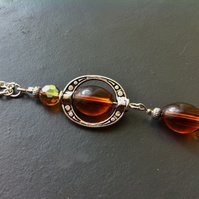 Amber glass necklace and earrings set in a Tibetan silver bead frame