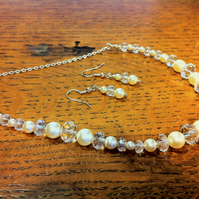 Cream Swarovski pearl and clear cut crystal necklace and earring set