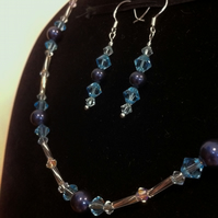 pale blue Swarovski crystal and dark blue Swarovski pearl necklace and earrings