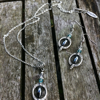Haematite, crystal and Tibetan silver bead framed necklace and earring set