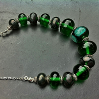 dark green and steel grey lampwork glass necklace
