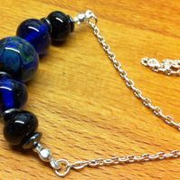 Lampwork beaded necklace in dark blue and black