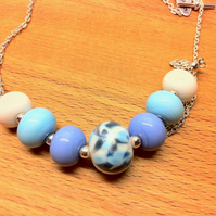 lampwork glass beaded necklace in white, sky blue and periwinkle with speckles