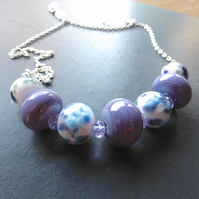 purple, blue, green and white lampwork bead necklace
