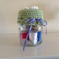 Glass jar with sewing accessories