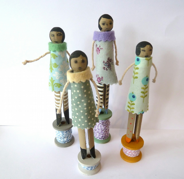 Set of four hand made peg and spool dolls