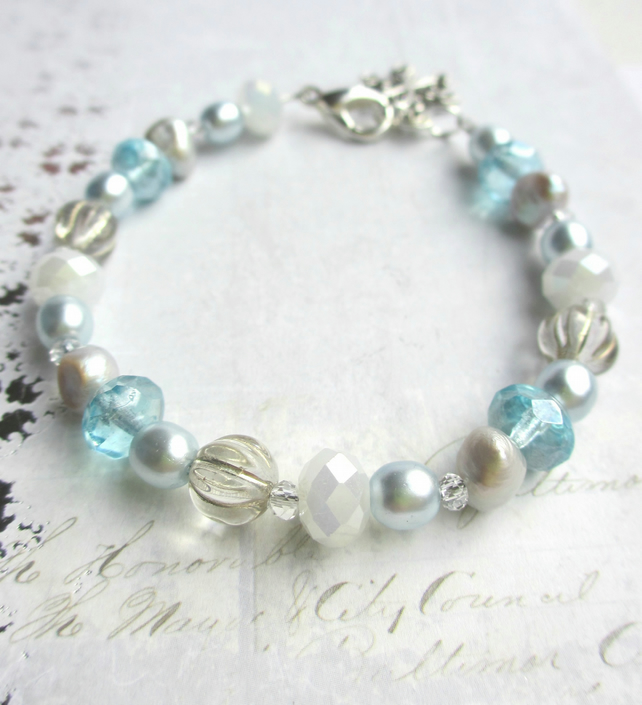Icy Blue Glass Bead Bracelet with Snowflake Charm