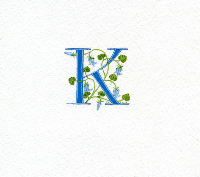 Initial letter K in turquoise with bluebells.