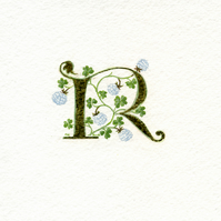 Initial letter R in 23c gold leaf with white clover gift letter..