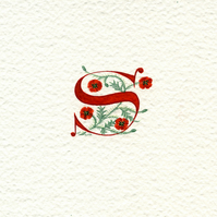 Initial letter 'S' in red with poppies custom letter.