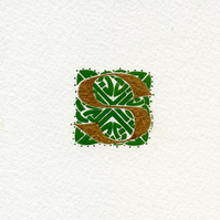 Letter S in gold with green Celtic knotwork panel.