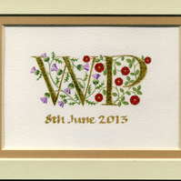 Double initials in gold leaf with Scots thistles and red roses