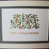 Wedding initials A M in gold with dark green leaves and date below