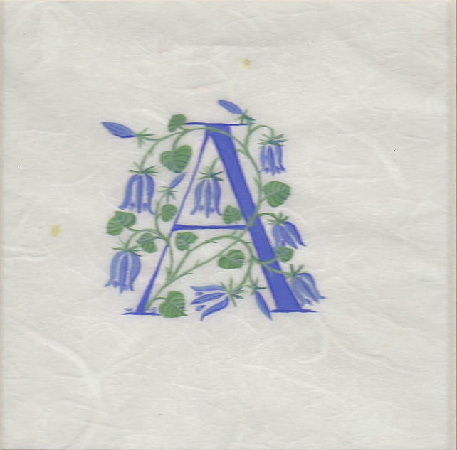 Initial letter 'A' in turquoise with bluebells on silk fibre paper.