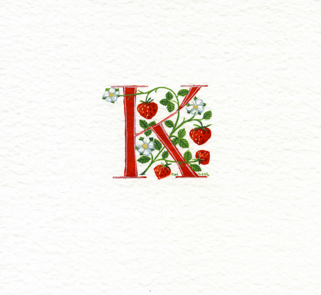 Initial letter 'K' in red with strawberries .