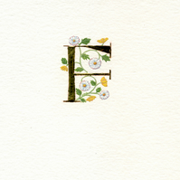 Initial letter 'F' in gold leaf with daisies and buttercups Special Birthday