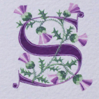 Letter 'S' in purple with Scots thistles custom initials.