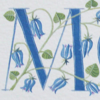 Initial letter M in turquoise with bluebells.
