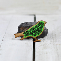 Hand drawn wooden bird brooch black on emerald green