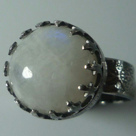 Rainbow Moonstone cabochon in sterling silver with textured band