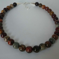 "Red Creek Jasper necklace silver accents 12mm beads 18"" to 19"" long"