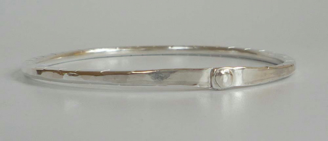 Silver bangle oval textured finish small to medium