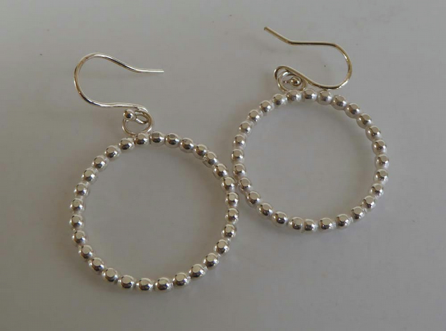 sterling silver hoop shaped earrings beaded wire