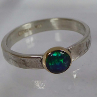 Blue Opal in gold and silver ring size M
